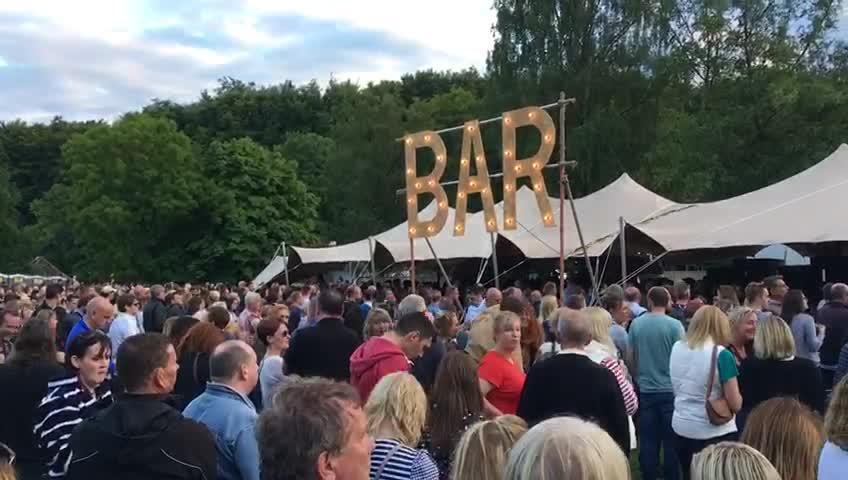Long bar queue by Rob Browne